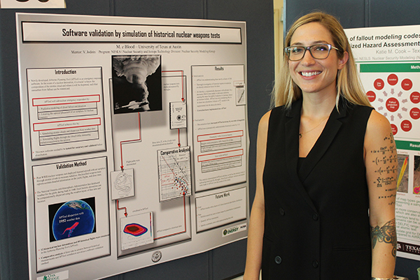Mikaela Blood standing next to poster presentation