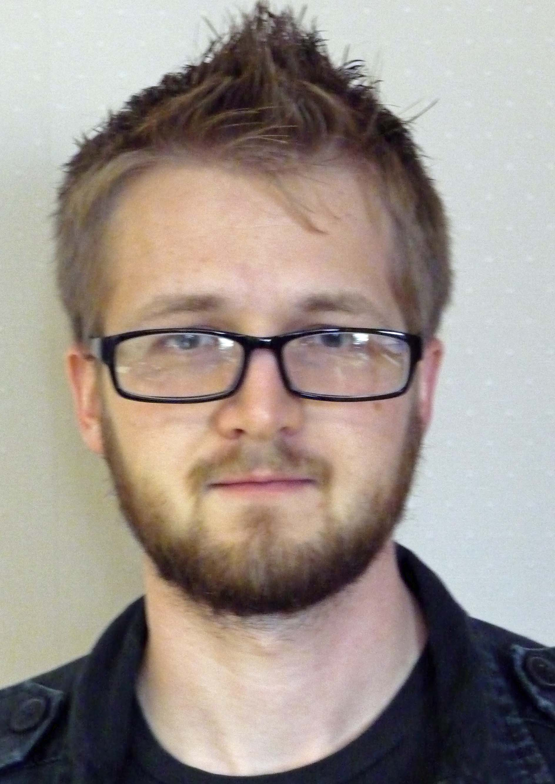 headshot of Ethan Moll